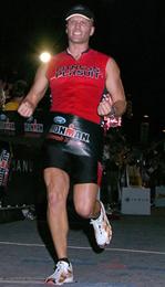 Matt Petersen crosses the finish line at Ironman Madison!